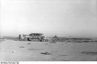 Imagine atasata: Bundesarchiv_Bild_101I-439-1276-05,_Nordafrika,_Zugkraftwagen_mit_Flak.jpg