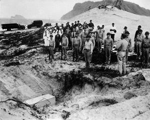 Imagine atasata: 748px-Body_of_Iida_is_buried_with_military_honors_by_U.S._troops.jpg