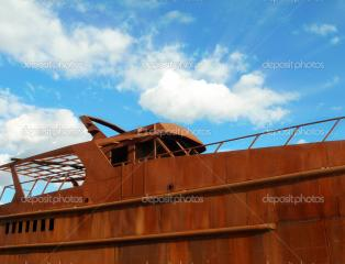 Imagine atasata: depositphotos_1110160-Rusty-Boat-on-blue-sky.jpg